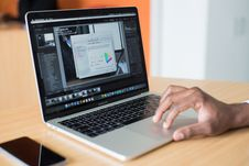 Free Person Operating Macbook Pro Royalty Free Stock Image - 114825666