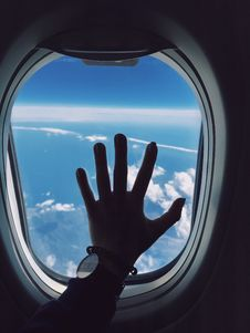 Free Photography Of Person S Left Hand Touching An Airplane S Window Stock Photos - 114825703