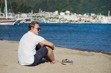 Free Photo Of Man In White Shirt And Blue Short Sitting On Seashore Stock Photo - 114825740