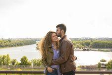 Free Man Wearing Brown Leather Jacket Hugging Woman Wearing Brown Zip-up Leather Jacket Royalty Free Stock Photos - 114825748