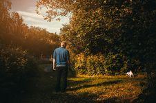Free Man Wearing Blue Jacket Looking Dog Peeing Royalty Free Stock Photo - 114892335