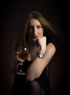 Free Woman Wearing Black Dress Holding Clear Wine Glass In Dark Room Stock Photography - 114892392