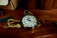 Free White Pocket Watch With Gold-colored Frame On Brown Wooden Board Stock Images - 114892394