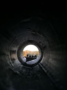 Free People Riding Canoe Boat View From Inside Pipe Stock Photo - 114892420