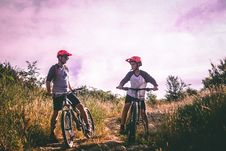 Free Two Man Riding Mountain Bike On Dirt Road At Daytime Royalty Free Stock Image - 114892426