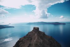 Free Island Under White Clouds Royalty Free Stock Image - 114892446