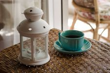 Free White Candle Lantern Beside Of Blue Ceramic Coffee Mug On Wicker Table Stock Image - 114892451