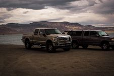 Free Photography Of Vehicles Near Lake Stock Photos - 114892543