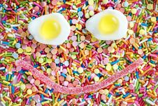 Free Fried Egg And Candy Forms Smiley Stock Photography - 114943882