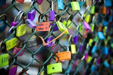 Free Green Chain-link Fence With Assorted-color Padlocks Stock Image - 114943911