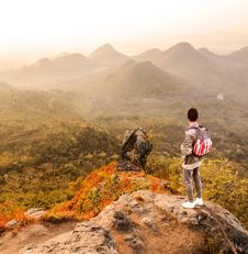 Free Man Standing On A Mountain Summit Royalty Free Stock Image - 114943956