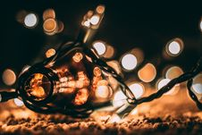 Free Low-light Photo Of Amber Glass Bottle With String Lights And Beige Bokeh Stock Photography - 114943972
