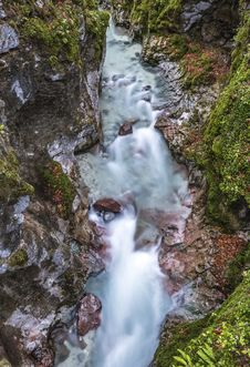 Free Body Of Water Between Cliffs Covered With Moss Stock Photo - 114943980