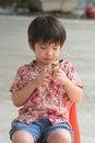 Free Boy Eating Ice-cream Royalty Free Stock Photography - 1157317