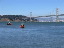 Two Cutters In San Francisco Bay, Bay Bridge In The Background Royalty Free Stock Images