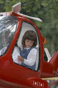 Young Girl In The Red Helicopter 02 Stock Images
