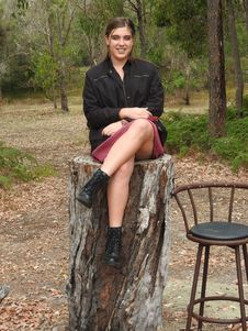 Free Woman Wearing Black Jacket Sitting On Tree Log Near Bar Stool Royalty Free Stock Photo - 115012855