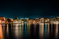 Free Cityscape Near Body Of Water During Nighttime Stock Photo - 115012860