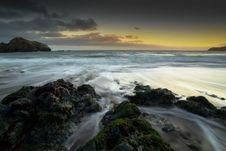 Free Rocks On Seashore During Golden Hour Stock Photo - 115012890