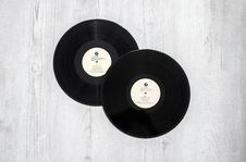 Free Photography Of Vinyl Records On Wooden Surace Royalty Free Stock Photography - 115013017
