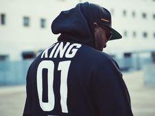 Free Man Wearing Black King 01-printed Hoodie And Flat Brim Cap Stock Photo - 115013040