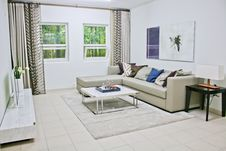 Free Gray Leather Sectional Sofa With White Coffee Table Stock Images - 115013114