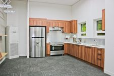 Free Stainless Steel Top-mount Refrigerator On Gray Carpet Royalty Free Stock Photo - 115013115