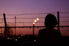 Free Silhouette Of Person In Front Of Fence Royalty Free Stock Images - 115110869