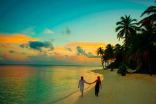 Free Man And Woman Holding Hand Walking Beside Body Of Water During Sunset Royalty Free Stock Photography - 115111077