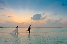 Free Man And Woman Standing At Seashore Stock Photos - 115111113