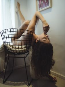 Free Photo Of Naked Woman Lying On Black Metal Chair Royalty Free Stock Photo - 115111135