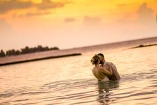 Free Woman And Man Kissing In Body Of Water Stock Images - 115111194