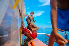 Free Teenage Boys Sitting On Edge Of Boat Royalty Free Stock Images - 115111309