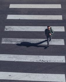 Free Man Crossing On Pedestrian Lane Stock Photos - 115203053
