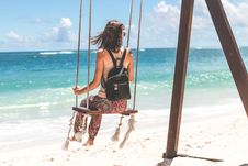 Free Woman Sitting On Seashore Swing Stock Photography - 115203072
