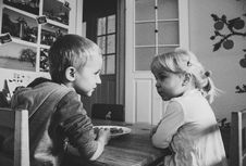 Free Grayscale Photo Of Boy And Girl Sitting On A Dining Table Chairs Royalty Free Stock Photo - 115203085