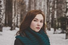 Free Selective Focus Photography Of Woman Wearing Blue Scarf While Standing On Snow Covered Forest Royalty Free Stock Images - 115203099