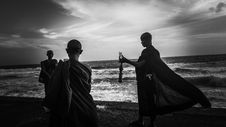 Free Greyscale Photography Of Three Monks Near Ocean Stock Photos - 115203163