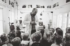 Free Grayscale Photo Of Man Lecturing Children Stock Photo - 115203180