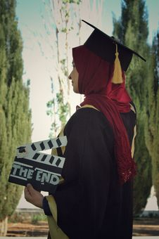 Free Woman Wearing Academic Dress While Holding Clipperboard Stock Images - 115203184