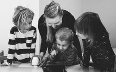Free Grayscale Photo Of Mother And Three Children Playing Royalty Free Stock Photos - 115203188