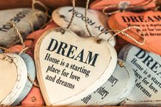 Free White And Orange Wooden Heart Dream Quote Decor Lot Stock Images - 115203214