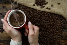 Free Person Holding Red Cup Of Coffee Cup With Coffee Above Coffee Beans Stock Photo - 115203220