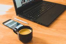 Free Black Laptop Computer And Black Ceramic Tea Cup Stock Images - 115269034