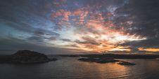 Free Body Of Water Near Mountains Taken Under Orange Clouds During Sunset Royalty Free Stock Image - 115269066