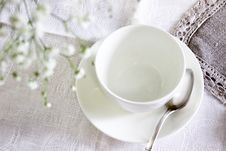 Free White Ceramic Tea Cup With Saucer And Spoon Royalty Free Stock Photography - 115269177