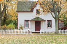 Free White And Red Wooden House With Fence Stock Photos - 115423303