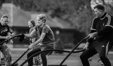 Free Grayscale Photography Of Two Men Using Exercise Ropes Stock Photos - 115423553
