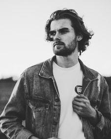 Free Grayscale Photo Of Man Wearing Denim Jacket Stock Photo - 115423580