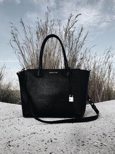 Free Black Michael Kors Leather 2-way Bag On Gray Surface Royalty Free Stock Photos - 115423628